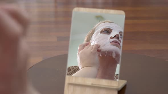 Mature Woman in Facial Mask for Face