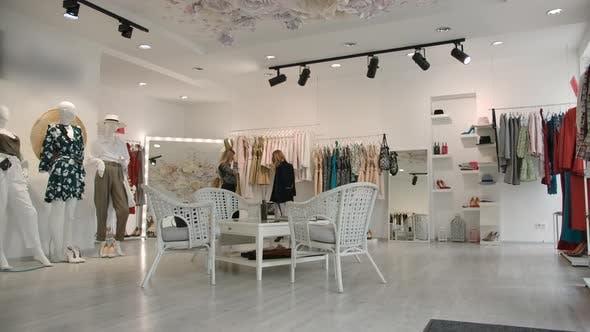Stylish Women Shopping in Boutique