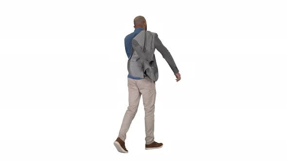 Thumbnail for Casual Man Putting Blazer on It Is Getting Cold on White Background.