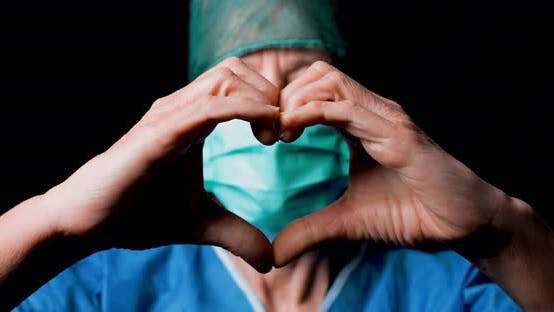 Thumbnail for Female Doctor Makes the Heart Symbol with her Hands.