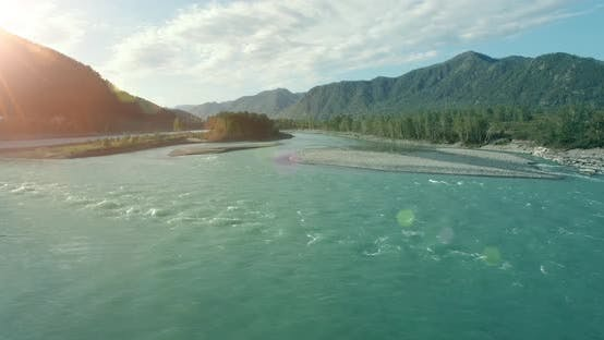 Cover Image for Low Altitude Flight Over Fresh Fast Mountain River with Rocks at Sunny Summer Morning