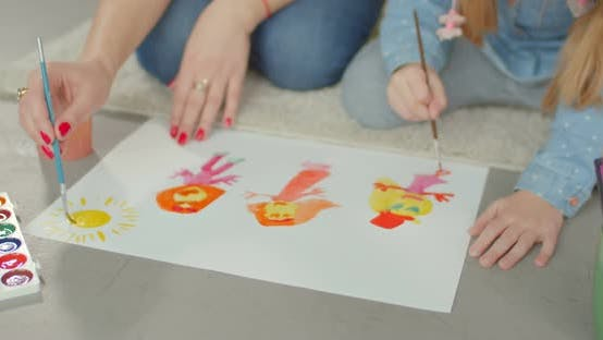 Thumbnail for Hands of Mother and Daughter Painting on Floor