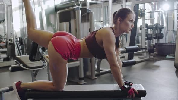 Thumbnail for Sporty Woman Doing Leg Lifts in Gym