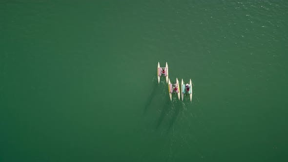 Thumbnail for Aerial view people on water bike pedal boats in Greece.
