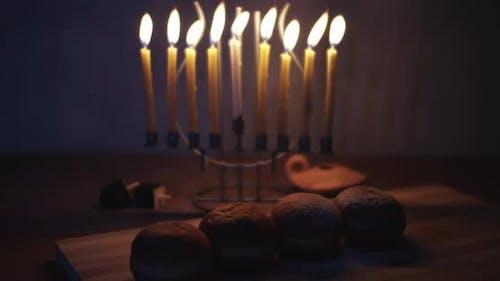 Hanukkah powdered doughnuts and a menorah