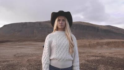Young Woman In Cowboy Hat In Icelandic Landscape