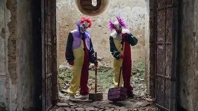 Two Scary Clowns Open The Door