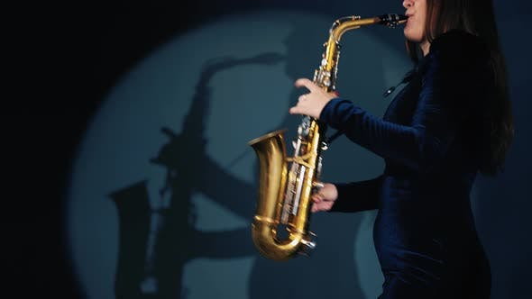 Thumbnail for Woman Plays on Saxophone. Musical Concept