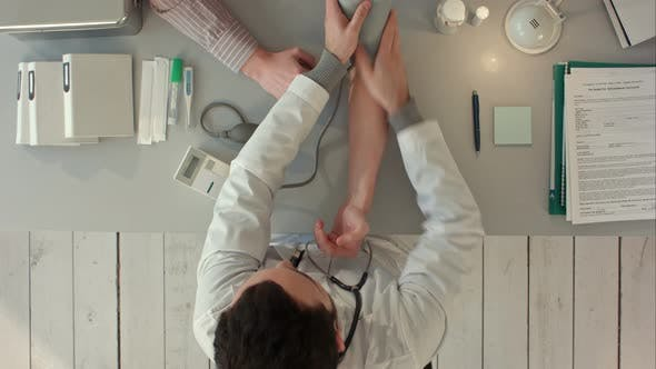 Thumbnail for Doctor Measuring Blood Pressure of a Patient