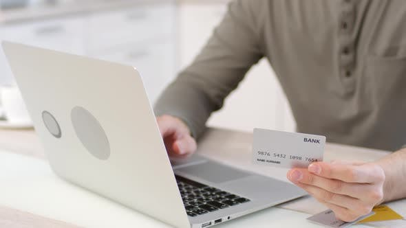 Thumbnail for Man Making Online Payment with Credit Card and Laptop