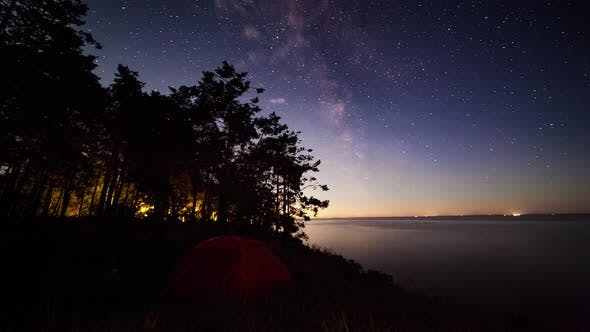 Thumbnail for Tent on the Lake at Night Under the Starry Sky. Timelapse