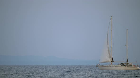 Thumbnail for White Yacht Sailing in Quiet Sea
