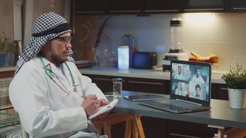 Arabic Doctor Making Zoom Video Conference with Doctors From Other Countries on Coronavirus Disease