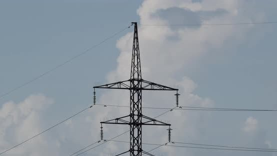 High Voltage Electric Tower On A Background Of Blue Sky