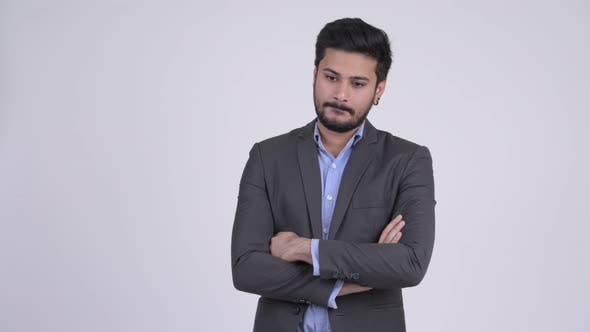 Thumbnail for Young Handsome Bearded Indian Businessman with Arms Crossed
