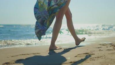 Female feet walking around water