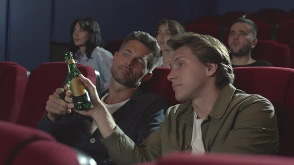 Thumbnail for Three Men Drinking Beer in Cinema