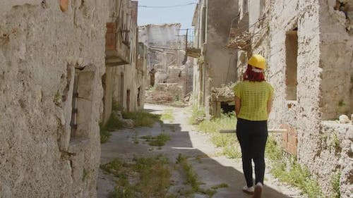 Female engineer looking at the city after the earthquake disaster