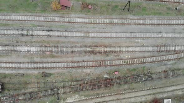 Thumbnail for Aerial view of empty railway tacks in the industrial part of the city