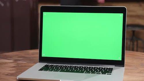 Parallax Shot of Modern Laptop with Green Screen