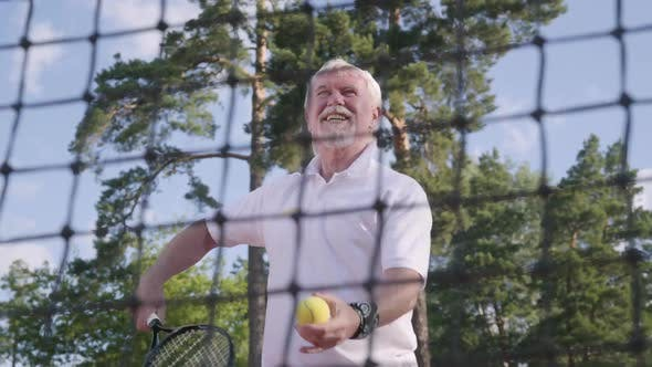 Thumbnail for Portrait Joyful Happy Smiling Mature Man Playing Tennis on the Tennis Court