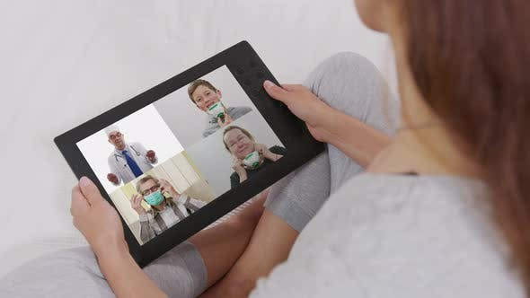Thumbnail for Woman Using Video Conferencing Technology for Video Call with Colleagues at Home and in Offices