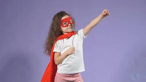 Portrait of Little Girl with Fluttering Cloak