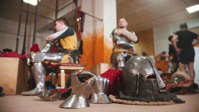Men in the Dressing Room Taking Off the Armour