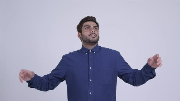 Thumbnail for Happy Young Bearded Indian Businessman Catching Something