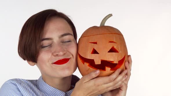 Thumbnail for Beautiful Woman Cuddling with Halloween Carved Jack Pumpkin
