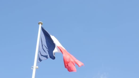 Thumbnail for Tricolor French flag in front of blue  waving 4K 3840X2160 UHD footage - Flag of France floating on
