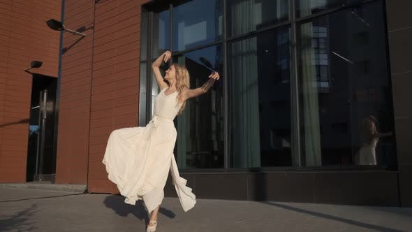 Thumbnail for Ballerina in a Flying Dress Dancing Beautifully on the Street