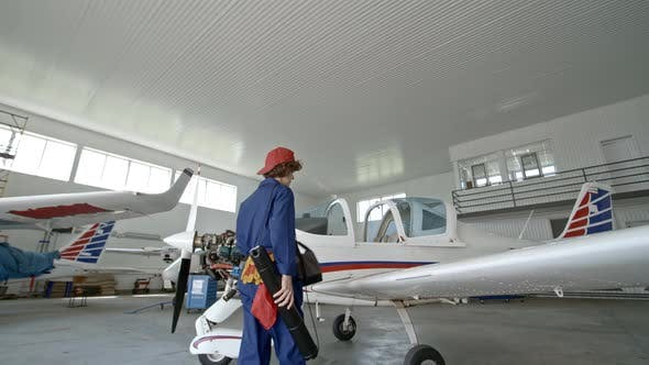 Cover Image for Female Engineer Working in Aircraft Hangar