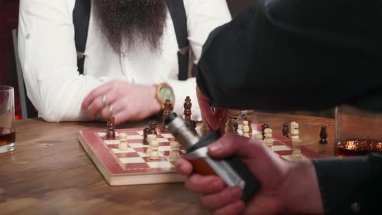 Thumbnail for Men Hands Moving Chess Figures and Smoking Heavily