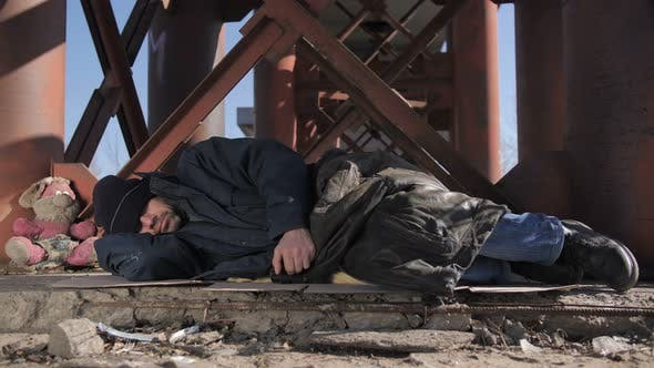 Thumbnail for Homeless Man Sleeping Outside in Cold Weather