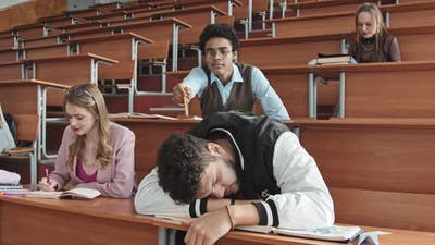 Bearded Young Student Sleeping at Class