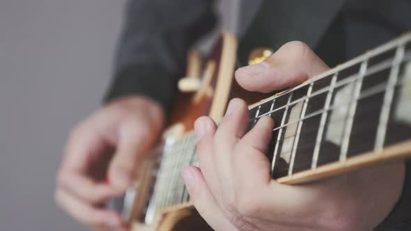 Thumbnail for Close up hands playing electric guitar. Fingers on guitar fretboard playing jazz and blues solo.