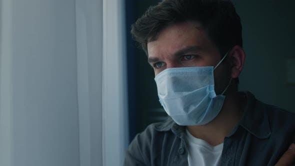 Brutal Sad Man Wearing Protective Medical Mask on Face