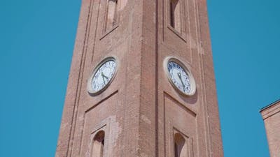 Ancient Bell Tower with Two Clocks