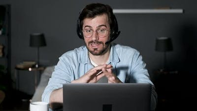 Young business man looking at camera webcam making conference video call with clients