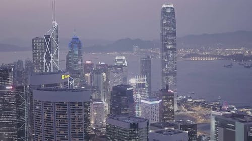 International Commerce Centre and Hong Kong downtown city skyline at night. Aerial drone view
