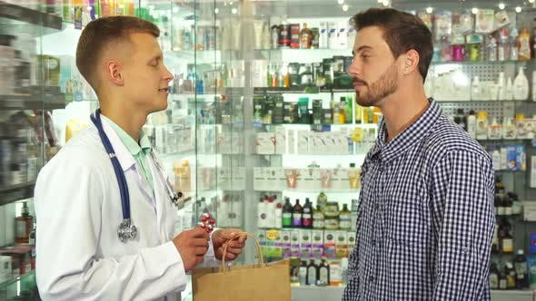 Thumbnail for Doctor Giving a Package with Pills To Patient