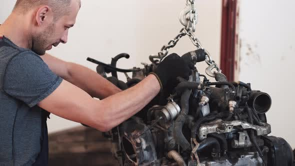 Thumbnail for Worker in Gloves Removing Engine of Car in Service Center