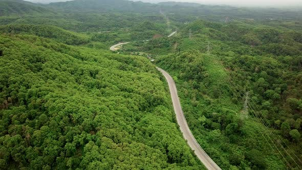 Cover Image for Aerial View Of Countryside Road Passing Through The Mountain Landscape 01