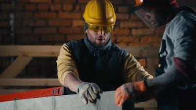 Multiethnic Contractors Discussing Measures of Brick Wall