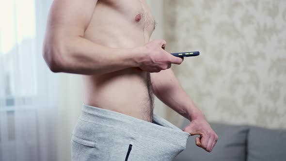 Man Taking a Picture of His Penis with a Smartphone