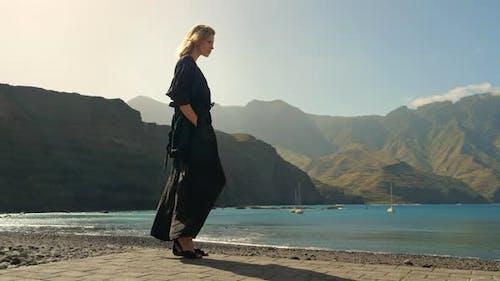 Blonde Model Standing Sideways Along the Beach in Gran Canaria