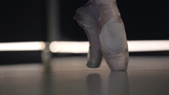 Thumbnail for Close-up of Ballerina's Feet in Pointes Balancing on Tiptoes. Professional Female Ballet Dancer