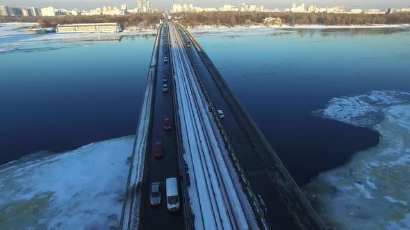 Thumbnail for Car Riding on Highway Bridge Over Winter River. Aerial View Winter City