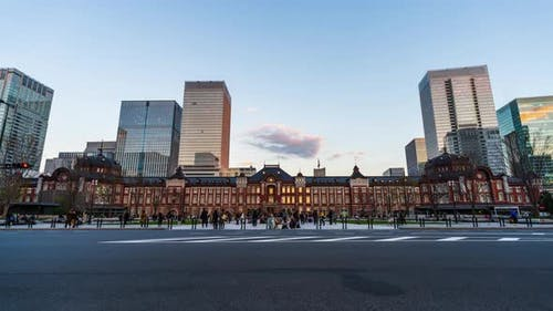 day to night time lapse of Tokyo Station in the Marunouchi business district, Japan